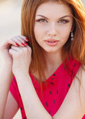 depositphotos_82452768-Portrait-of-beautiful-woman-with-red-hair